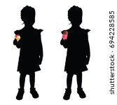 child with ice cream silhouette ... | Shutterstock .eps vector #694228585