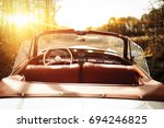 retro car in autumn forest with ... | Shutterstock . vector #694246825