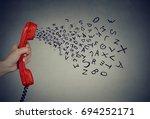 hand holding telephone handset... | Shutterstock . vector #694252171