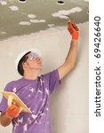man holding a trowel   Shutterstock . vector #69426640