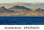 view from a boat of porto santo.... | Shutterstock . vector #694296631