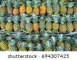 pineapples on the shelf. it is... | Shutterstock . vector #694307425
