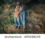 traveler couple hugging while... | Shutterstock . vector #694338145
