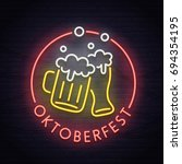 oktoberfest neon sign  bright... | Shutterstock .eps vector #694354195