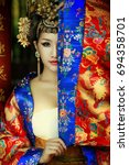 The beautiful lady in Chinese dress.