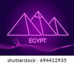 neon pyramids. sight of egypt.... | Shutterstock .eps vector #694412935