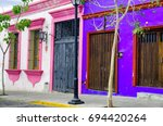 view of pink and blue colonial...   Shutterstock . vector #694420264