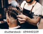 close up of a young hipster guy ... | Shutterstock . vector #694440109
