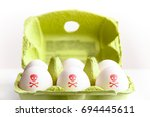 eggs in a green paper package... | Shutterstock . vector #694445611