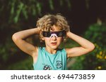 child wearing solar eclipse