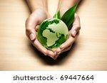 glass globe in hand   Shutterstock . vector #69447664