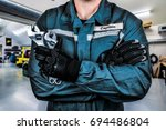 mechanic in the garage | Shutterstock . vector #694486804