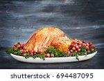delicious golden roasted... | Shutterstock . vector #694487095