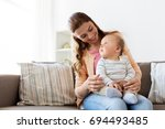 family  child and motherhood... | Shutterstock . vector #694493485