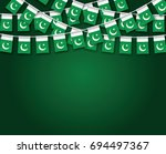 garland flags with dark green... | Shutterstock .eps vector #694497367