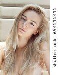a beautiful young blonde woman... | Shutterstock . vector #694515415