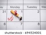 cigarette on calendar. time to... | Shutterstock . vector #694524001