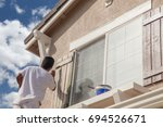 professional house painter... | Shutterstock . vector #694526671