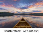 Bow Of A Cedar Canoe On A Lake...