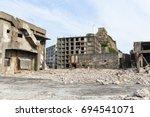 destroyed buildings on... | Shutterstock . vector #694541071