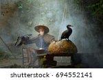 fisherman and cormorant  ... | Shutterstock . vector #694552141