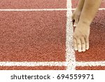 the hands on starting line in...   Shutterstock . vector #694559971