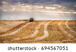 rolls of sloping wheat in the... | Shutterstock . vector #694567051