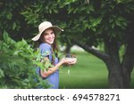 adorable girl in sun hat... | Shutterstock . vector #694578271