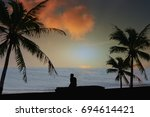 Small photo of Silhouette Concept Men sit alone sit relax With atmosphere Sea sky In the evening.