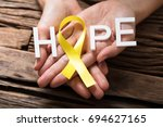 person's hand showing ribbon... | Shutterstock . vector #694627165