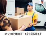 cargo delivery  courier gives... | Shutterstock . vector #694653565
