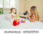 mother  photographer... | Shutterstock . vector #694655944