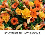 orange coffin flowers   Shutterstock . vector #694680475