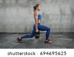 young muscular girl in training ... | Shutterstock . vector #694695625