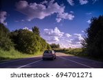 car on the road somewhere in... | Shutterstock . vector #694701271