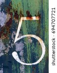 house number in rusty metal door | Shutterstock . vector #694707721