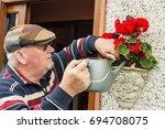 senior citizen male outdoors... | Shutterstock . vector #694708075
