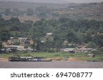 shack village by the congo... | Shutterstock . vector #694708777