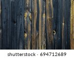 a fragment of the old wooden... | Shutterstock . vector #694712689