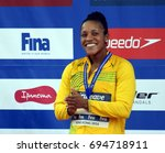 Small photo of Hong Kong, China - Oct 30, 2016. ATKINSON Alia (JAM) at the Victory Ceremony of Women's Butterfly 50m. FINA Swimming World Cup.