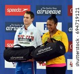 Small photo of Hong Kong, China - Oct 30, 2016. Cluster winners MOROZOV Vladimir (RUS) and ATKINSON Alia (JAM) with gift bag. FINA Swimming World Cup