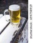 a glass of fresh beer on a...   Shutterstock . vector #694758919