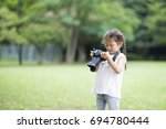 happy little girl taking... | Shutterstock . vector #694780444