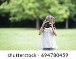 Happy Little Girl Taking...