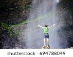 boy enjoys the gocta waterfall... | Shutterstock . vector #694788049
