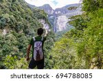 young tourist pointing with... | Shutterstock . vector #694788085