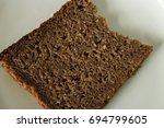 Small photo of Slice of healthy dark bread