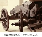 An Old Wooden Carriage With An...