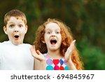 surprised little children smile ...   Shutterstock . vector #694845967