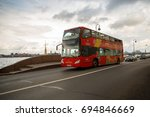 a red two story excursion bus... | Shutterstock . vector #694846669